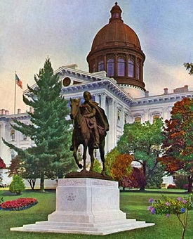 The Circuit Rider statue stands in front of the 1876 State Capitol