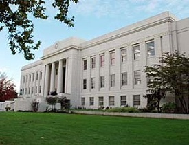 Linn County courthouse, a 3 story white marble building.