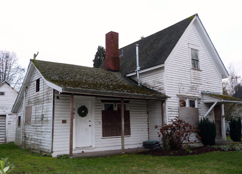 One-story dwelling with a mud-mortared chimney. A two-story addition was added to the side of the house.