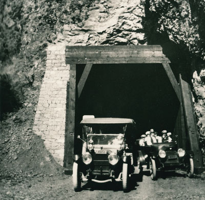A car passes another car as they leave the west end of the Oneonta Tunnel in 1916