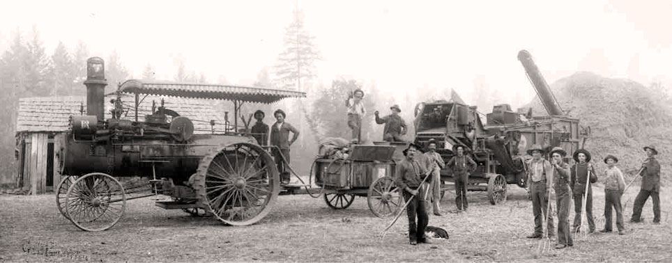 A steam tractor and farm equipment