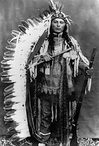 A Native American with full head dress