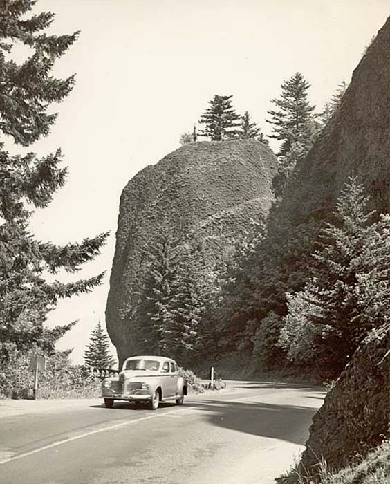 The highway curves around a large domed rock known as Bishop's Cap or Mushroom Rock.
