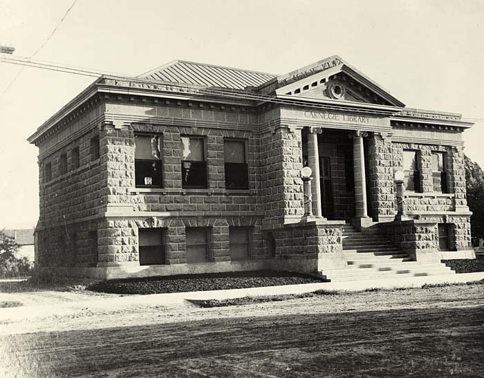 The Carnegie public library, a stone building in modified classical revival design.