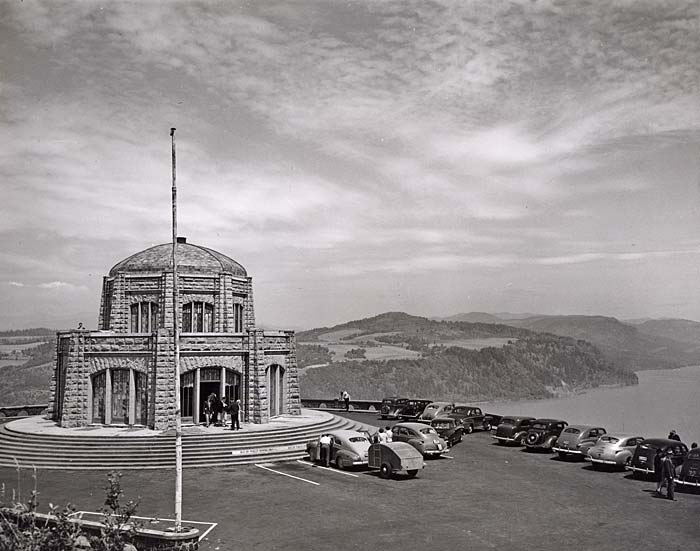 A domed stone building sits a top a high cliff looking over the Columbia Gorge.