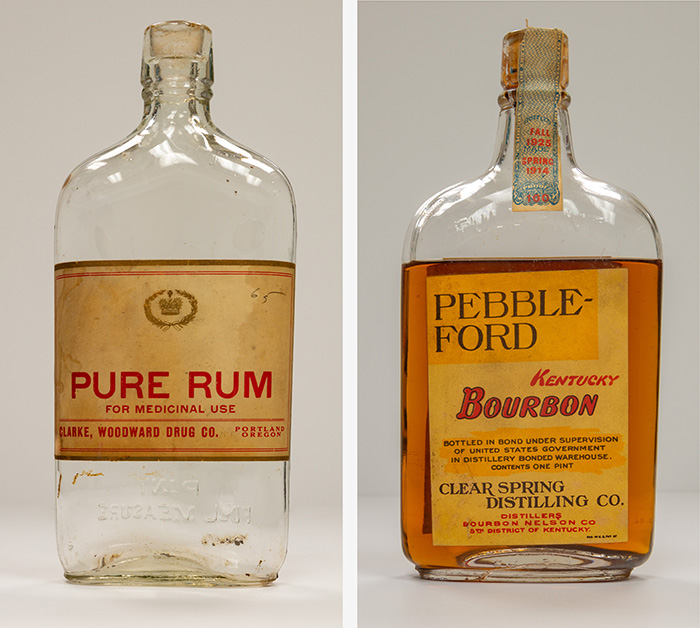 Clear glass bottles with labels reading: Pure Rum, for medicinal use. Pebble-Ford, Kentucky Bourbon, Clear Spring Distilling Co.