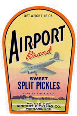 "Airplaine flying over field with trees in background. Reads ""Airport brand sweet split pickles"""