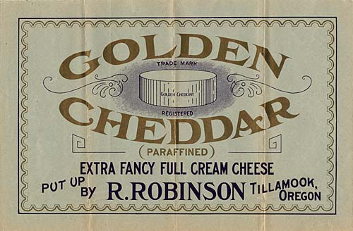 "Drawing of cheddar wheel of cheese with the words ""Golden Cheddar"" arched around."