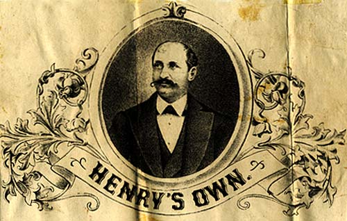 "Drawing of man in suit with mustache in oval. Below a banner reads ""Henry's Own"""