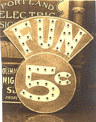 "Photo of sign with lights reads ""Fun 5c"" outside a building."