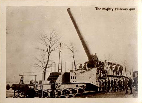 "Artillery gun with mussle pointed skyward. Words ""The Mighty Railway gun"" printed on photo."