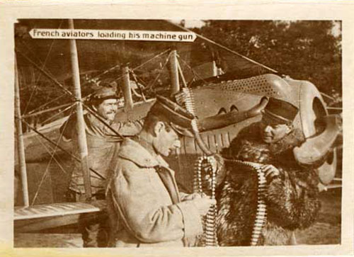 French aviator loading his machine gun on his plane