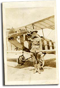 Charles P. Hoffman in front of his airplane.
