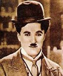 Charlie Chaplin in hat, suit and tie.