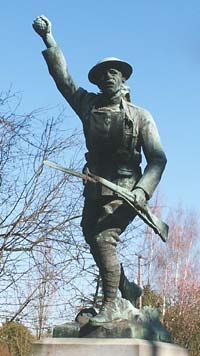 Stone statue of soldier carrying rifle