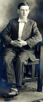 Corporal Frank Burns sitting in a chair for formal photo.
