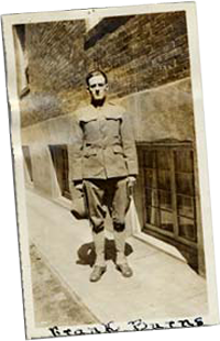 Frank Burns stands on street corner wearing his uniform.
