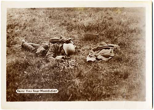 German soldier lies face down, dead, in a field.