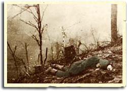 German soldier lies dead on hillside.