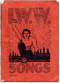 Song book of the IWW shows a man reaching 1 arm forward and industrial building with smoke stacks in background.
