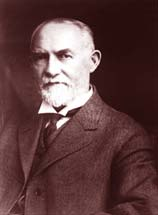 Gov. James Withycombe: A gray bearded man in suit and tie.