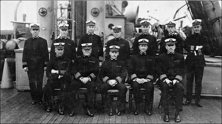 Officers of Mine Squadron One on deck of ship.