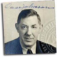 Photograph of Oscar Johnson in a suit. His signature in blue ink across the top.