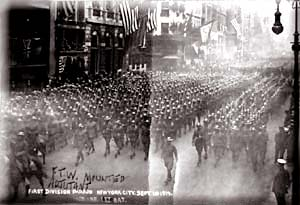 Black and white photo of hundreds of soldiers marching down a street in NY.