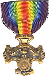 "Service medal with rainbow striped ribbon. The medal shows an eagle with the words ""World War Service"""