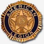 "An American Legion gold badge. Circle shaped with a star in the center and ""American Legion"" writen around the circumfrence."