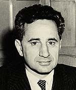Photo of Elia Kazan in suit and tie.