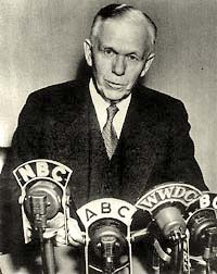 Photo of George C. Marshall in suit & tie speaking in front of news microphones. The microphones are each labeld: NBC, ABC, WWDC