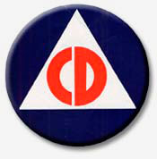 "Letters ""CD"" inside white triangle inside blue circle."