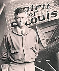 Photo of Charles Lindbergh standing in front of airplane.