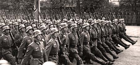German soldiers marching in lines with legs kicked high when stepping.