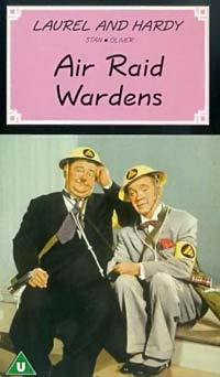 "Photo of Laurel and Hardy with the headline ""Air Raid Wardens"" over the top."
