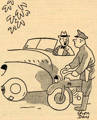 Man in a car talks to a policeman on a motorcycle.