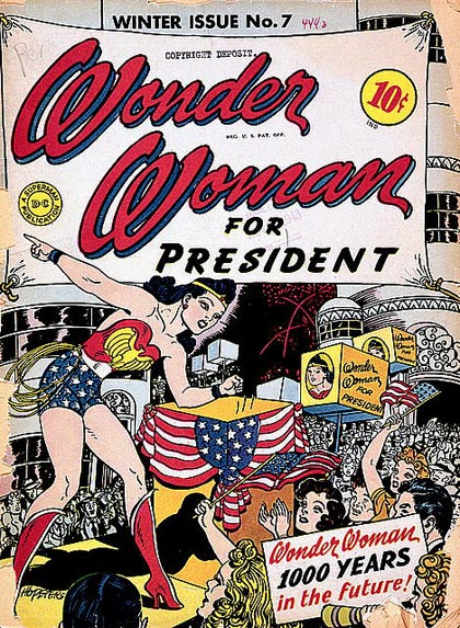 "Cartooon of Wonder Woman on a stage giving a speach to supporters. Sign in back says ""Wonder Woman for President"""