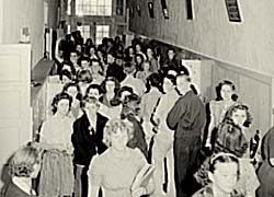 Photo of a crowded high school hall with little room for movement.