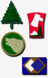 Patches in shape of evergreen tree, oval with a wolf profile, 1 shape of a stump with an ax & a tree, 1 with hexagon and squares