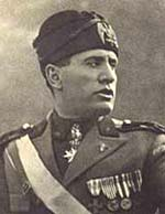 Benito Mussolini in his military formal wear with many medals pinned to the front.