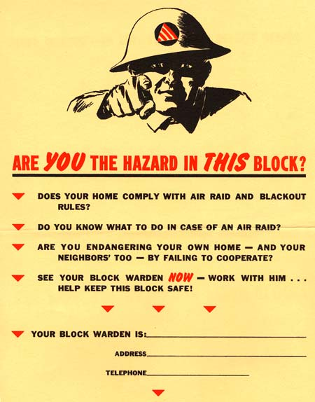 "Man in military hat points ""Are YOU the hazard in THIS block?"""
