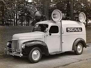"1940s truck with sirens on top and word ""Signal"" printed on side."
