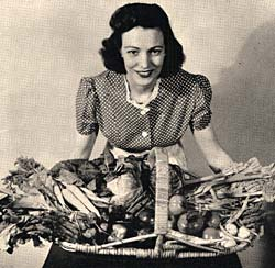 Photo of woman holding basket of vegtables.