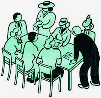 8 people gather around a table to hold a meeting.