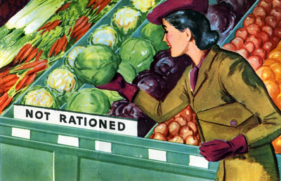 "Woman in the fresh produce section picking up a cauliflower from a section with a sign reading ""Not Rationed."""