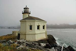 Lighthouse on a rock outcrop along the oregon coast.