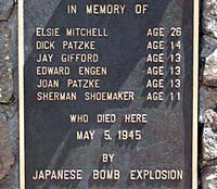 "Wall plaque reads ""in Memory of"" and the 6 names who died May 5, 1945 by Japanese bomb explosion."