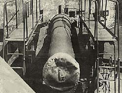 Cannon shown with steel scaffolding for walking along at the sides.