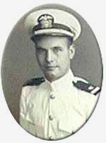 Photo of man in white military dress with hat.